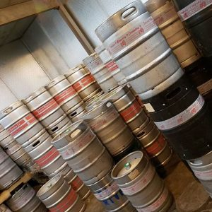 Stacked kegs in a large fridge