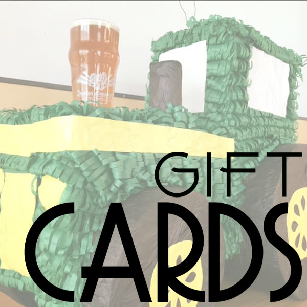 Gift Cards with tractor pinata and a pint in the background