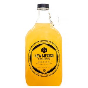 New Mexico Ferments Kombucha Clear Glass Growler with yellow liquid